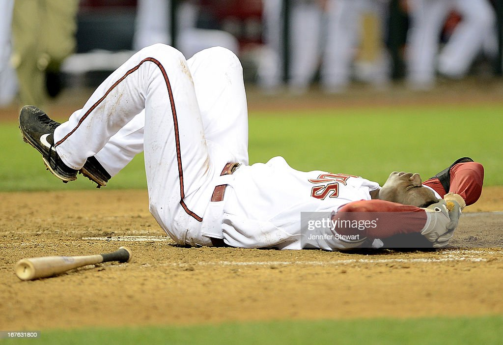 Didi Gregorius #1 of the Arizona Diamondbacks lies on the ground after being hit in the head by a pitch from Josh Outman (not pictured) of the Colorado Rockies in the seventh inning at Chase Field on April 26, 2013 in Phoenix, Arizona.