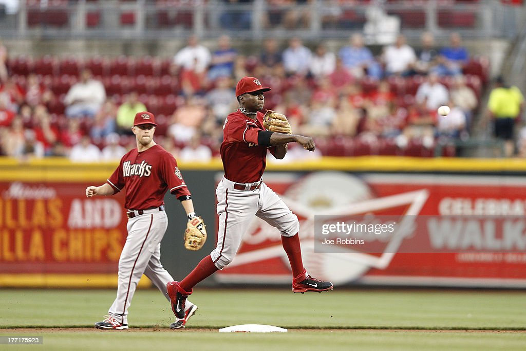 <a gi-track='captionPersonalityLinkClicked' href=/galleries/search?phrase=Didi+Gregorius&family=editorial&specificpeople=8945889 ng-click='$event.stopPropagation()'>Didi Gregorius</a> #1 of the Arizona Diamondbacks makes a play at shortstop against the Cincinnati Reds during the game at Great American Ball Park on August 21, 2013 in Cincinnati, Ohio.