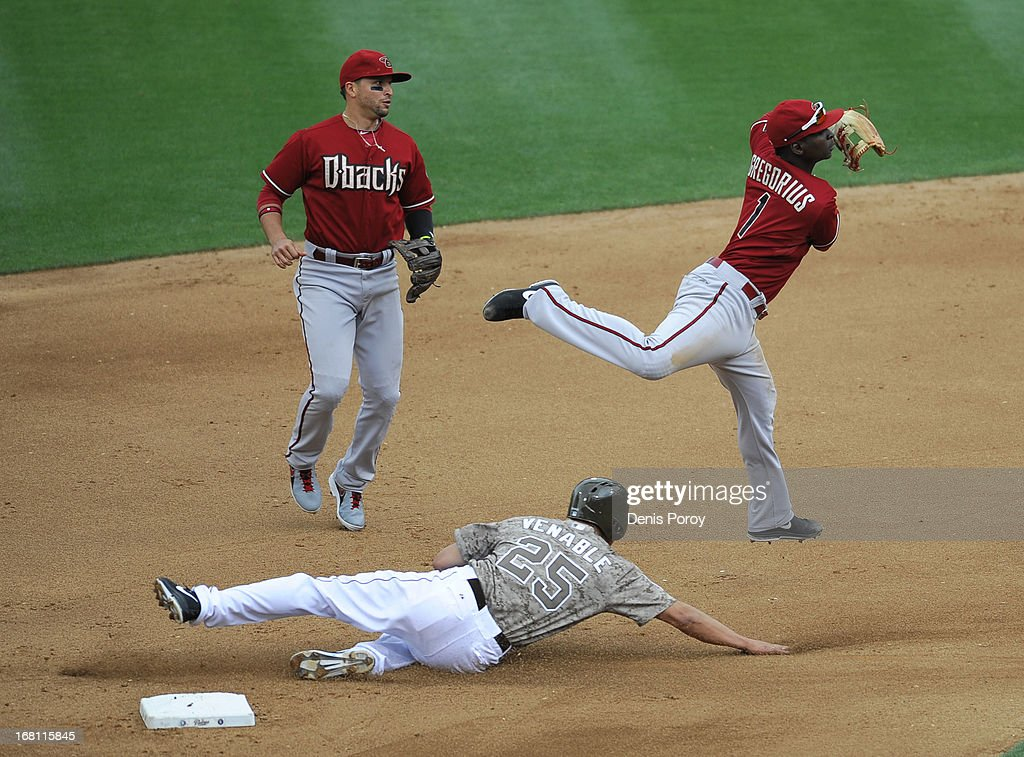 Didi Gregorius #1 of the Arizona Diamondbacks throws over <a gi-track='captionPersonalityLinkClicked' href=/galleries/search?phrase=Will+Venable&family=editorial&specificpeople=3068470 ng-click='$event.stopPropagation()'>Will Venable</a> #25 of the San Diego Padres to turn a double play as <a gi-track='captionPersonalityLinkClicked' href=/galleries/search?phrase=Martin+Prado&family=editorial&specificpeople=620159 ng-click='$event.stopPropagation()'>Martin Prado</a> #14 looks on during the fourth inning of a baseball game at Petco Park on May 5, 2013 in San Diego, California.