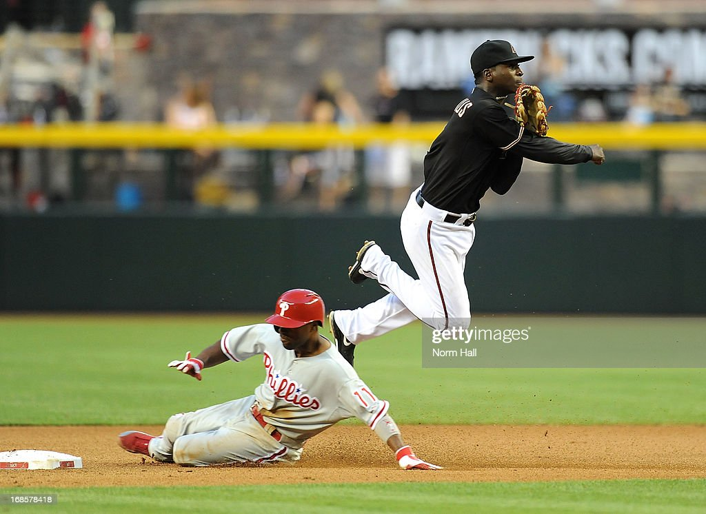 Didi Gregorius #1 of the Arizona Diamondbacks turns a double play as Jimmy Rollins #11 of the Philadelphia Phillies slides into second base at Chase Field on May 11, 2013 in Phoenix, Arizona.