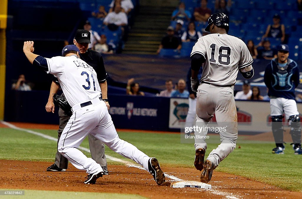 Didi Gregorius #18 of the New York Yankees beats pitcher Xavier Cedeno #31 of the Tampa Bay Rays to first base off of his fielder's choice during the sixth inning of a game on May 13, 2015 at Tropicana Field in St. Petersburg, Florida.