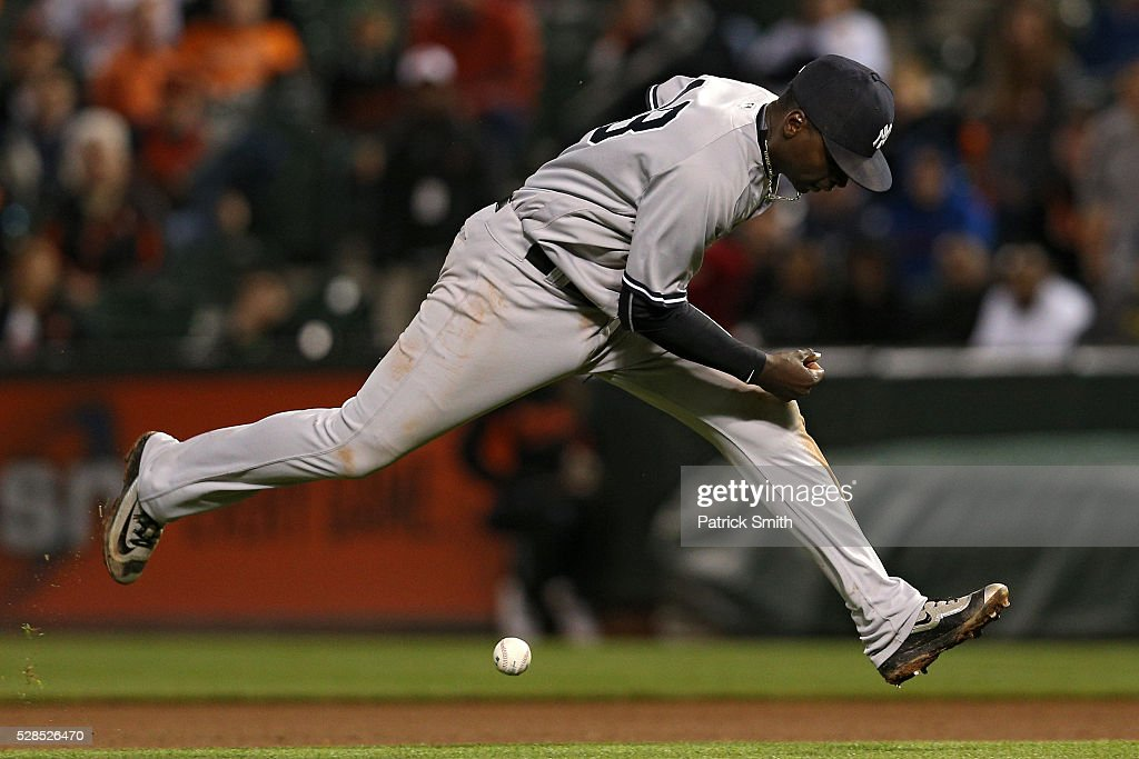 <a gi-track='captionPersonalityLinkClicked' href=/galleries/search?phrase=Didi+Gregorius&family=editorial&specificpeople=8945889 ng-click='$event.stopPropagation()'>Didi Gregorius</a> #18 of the New York Yankees cannot handle a ball hit by Hyun Soo Kim #25 of the Baltimore Orioles (not pictured) during the tenth inning at Oriole Park at Camden Yards on May 5, 2016 in Baltimore, Maryland. The Baltimore Orioles won, 1-0, in the tenth inning.