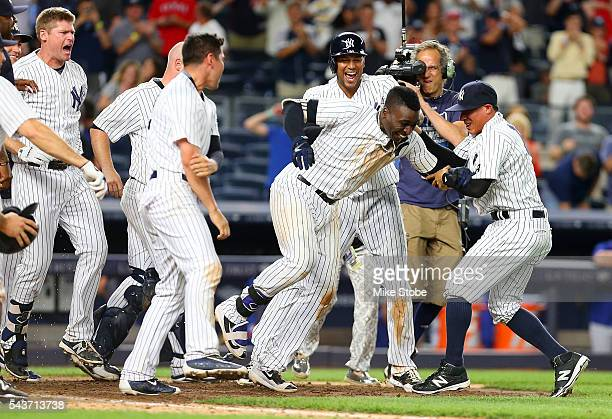 Didi Gregorius of the New York Yankees celebrates after hitting a game winning tworun home run in the bottom of the ninth inning against the Texas...