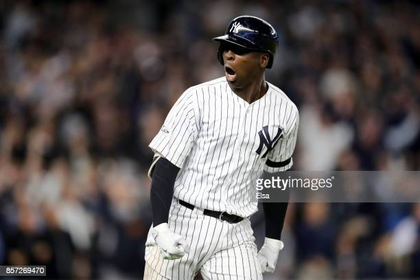 Didi Gregorius of the New York Yankees celebrates after hitting a three run home run against Ervin Santana of the Minnesota Twins during the first...