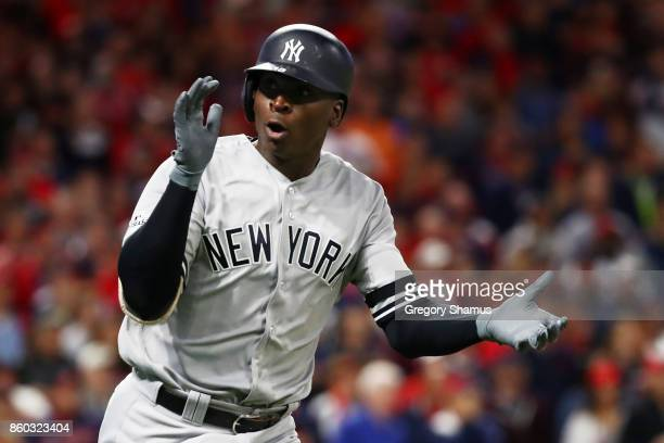 Didi Gregorius of the New York Yankees celebrates as he runs the bases after hitting a solo homerun in the first inning against the Cleveland Indians...