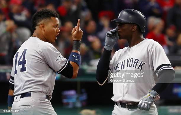 Didi Gregorius of the New York Yankees celebrates his solo homerun with Starlin Castro in the first inning against the Cleveland Indians in game five...