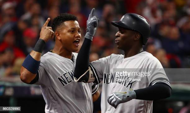 Didi Gregorius of the New York Yankees celebrates his tworun homerun with Starlin Castro in the third inning against the Cleveland Indians in game...