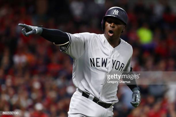 Didi Gregorius of the New York Yankees celebrates his tworun homerun as he runs the bases in the third inning against the Cleveland Indians in game...