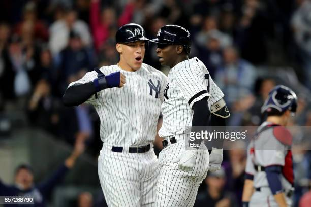 Didi Gregorius of the New York Yankees celebrates with Aaron Judge after hitting a three run home run against Ervin Santana of the Minnesota Twins...