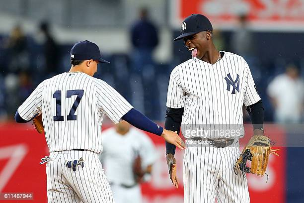 Didi Gregorius of the New York Yankees celebrates with Ronald Torreyes after defeating the Boston Red Sox 51 at Yankee Stadium on September 29 2016...