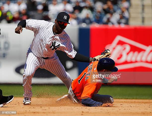 Didi Gregorius of the New York Yankees drops the ball as Carlos Correa of the Houston Astros steals second base in the fourth inning during Opening...