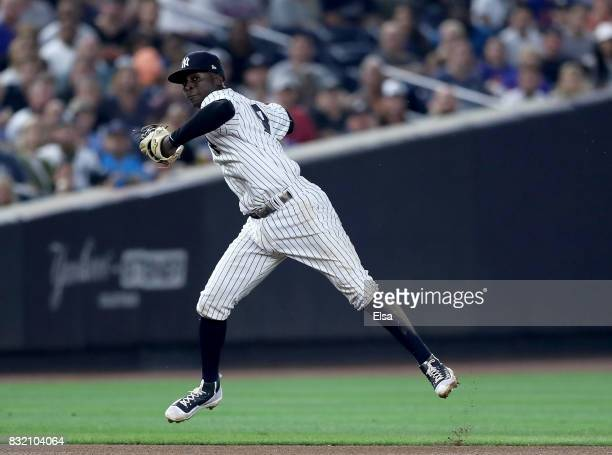 Didi Gregorius of the New York Yankees fields a hit by Yoenis Cespedes of the New York Mets in the fourth inning during interleague play on August 15...