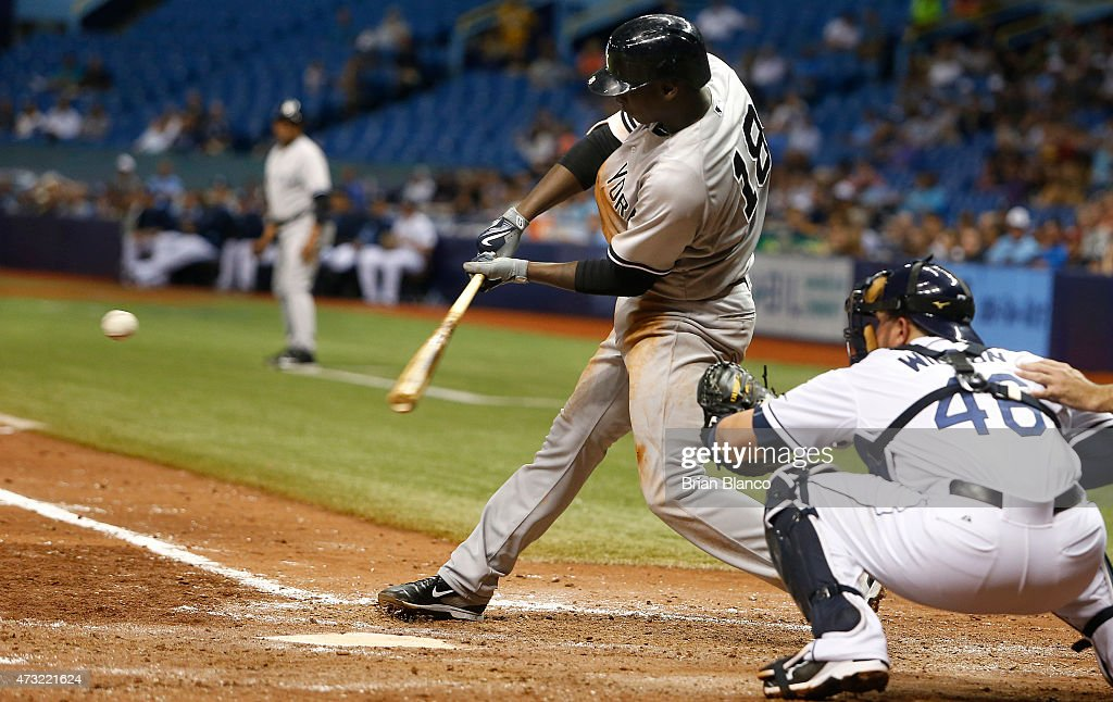 Didi Gregorius #18 of the New York Yankees hits a fielder's choice in front of catcher Bobby Wilson #46 of the Tampa Bay Rays during the sixth inning of a game on May 13, 2015 at Tropicana Field in St. Petersburg, Florida.
