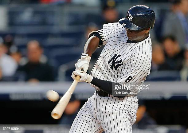 Didi Gregorius of the New York Yankees hits a home run during the second inning against the Oakland Athletics at Yankee Stadium on April 20 2016 in...