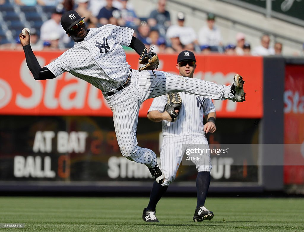 <a gi-track='captionPersonalityLinkClicked' href=/galleries/search?phrase=Didi+Gregorius&family=editorial&specificpeople=8945889 ng-click='$event.stopPropagation()'>Didi Gregorius</a> #18 of the New York Yankees makes an error on a ball hit by Devon Travis #29 of the Toronto Blue Jays in the third inning during their game at Yankee Stadium on May 26, 2016 in New York City.