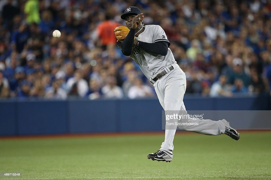 Didi Gregorius #18 of the New York Yankees makes the play and throws out the baserunner in the fifth inning during MLB game action against the Toronto Blue Jays on September 23, 2015 at Rogers Centre in Toronto, Ontario, Canada.