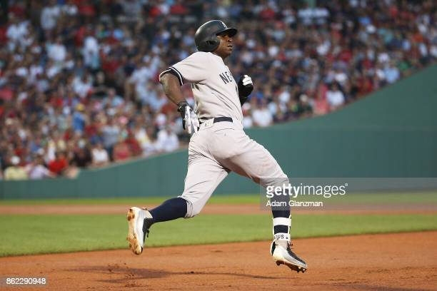 Didi Gregorius of the New York Yankees runs to first base during a game against the Boston Red Sox at Fenway Park on August 19 2017 in Boston...