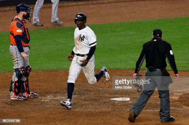 Didi Gregorius of the New York Yankees scores on a tworun goahead double by Gary Sanchez during the eighth inning against the Houston Astros in Game...