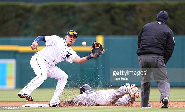 Didi Gregorius of the New York Yankees steals second base as Hernan Perez of the Detroit Tigers attempts to catch the ball during the third inning of...