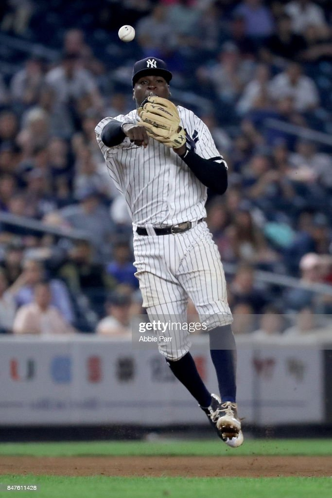 Didi Gregorius #18 of the New York Yankees throws a runner out in the ninth inning against the Baltimore Orioles on September 15, 2017 at Yankee Stadium in the Bronx borough of New York City.