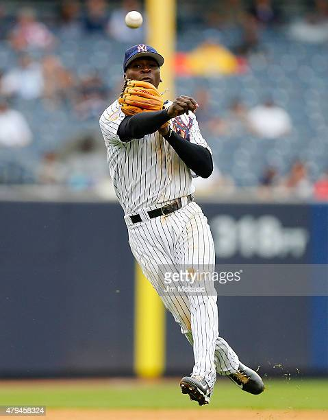 Didi Gregorius of the New York Yankees throws for an out in the fourth inning against the Tampa Bay Rays at Yankee Stadium on July 4 2015 in the...