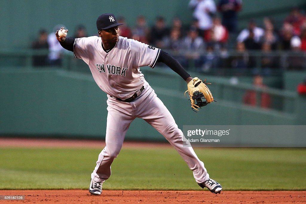 <a gi-track='captionPersonalityLinkClicked' href=/galleries/search?phrase=Didi+Gregorius&family=editorial&specificpeople=8945889 ng-click='$event.stopPropagation()'>Didi Gregorius</a> #18 of the New York Yankees throws to first base in the first inning during the game against the Boston Red Sox at Fenway Park on April 29, 2016 in Boston, Massachusetts.