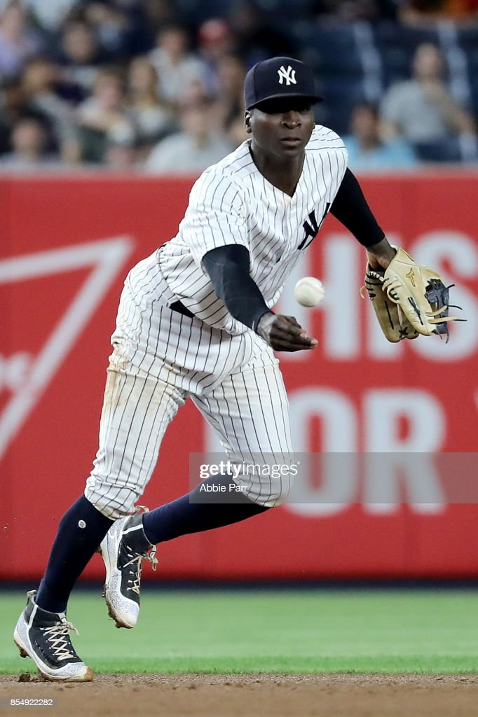 Didi Gregorius #18 of the New York Yankees tosses the ball to second in the seventh inning against the Tampa Bay Rays at Yankee Stadium on September 27, 2017 in the Bronx borough of New York City.