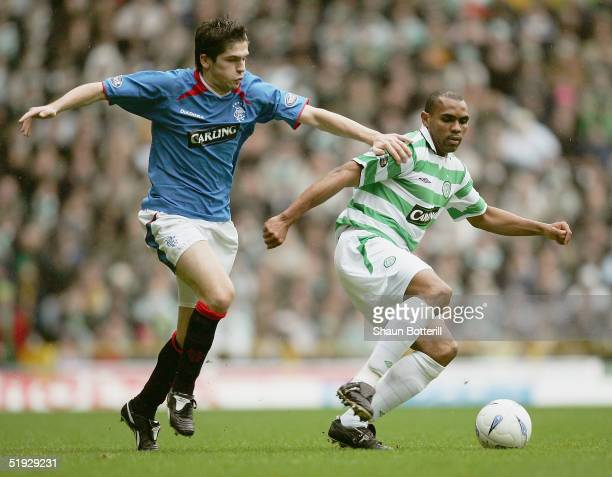 Didier Agathbe of Celtic is challenged by Bojan Djordjic of Rangers during the Tennants Scottish Cup 3rd round match between Celtic and Rangers at...