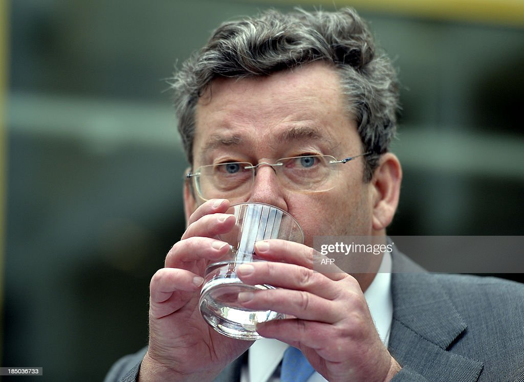 <a gi-track='captionPersonalityLinkClicked' href=/galleries/search?phrase=Didier+Bellens&family=editorial&specificpeople=878481 ng-click='$event.stopPropagation()'>Didier Bellens</a>, CEO of Belgacom, drinks a glass of water during a session of the Chamber Commission Infrastructure at the federal parliament in Brussels on October 17, 2013. The Commission is discussing the sale of the 'Stro - Paille' Belgacom building located in the Strostraat - Rue de la Paille in Brussels. A possible conflict of interest has risen as Belgacom CEO <a gi-track='captionPersonalityLinkClicked' href=/galleries/search?phrase=Didier+Bellens&family=editorial&specificpeople=878481 ng-click='$event.stopPropagation()'>Didier Bellens</a> is also a member of the board of Immobel, the intentional buyer of the building. BELGA