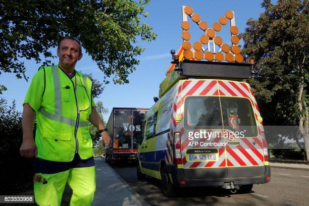 Didier Carton a motorway patroller on the highway A11 stands by his vehicle on July 21 on the side of the A11 motorway in EureetLoire During the...
