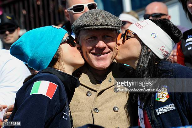 Didier Cuche of Switzerland celebrates his retirement and is kissed by Irene Curtoni and Federica Brignone during the Audi FIS Alpine Ski World Cup...