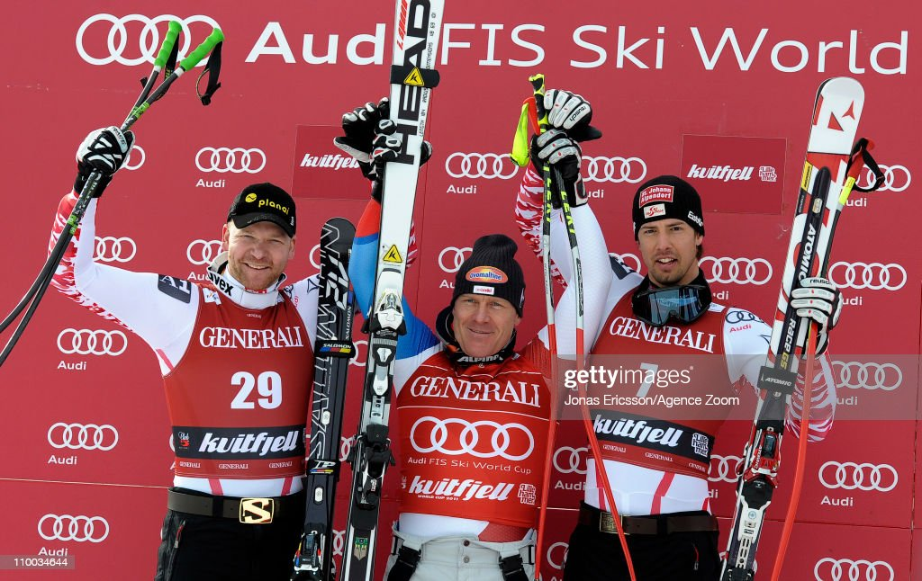 <a gi-track='captionPersonalityLinkClicked' href=/galleries/search?phrase=Didier+Cuche&family=editorial&specificpeople=238957 ng-click='$event.stopPropagation()'>Didier Cuche</a> of Switzerland takes 1st place, Klaus Kroell of Austria takes 2nd place, Joachim Puchner of Austria takes 3rd place during the Audi FIS Alpine Ski World Cup Men's SuperG on March 13, 2011 in Kvitfjell, Norway.