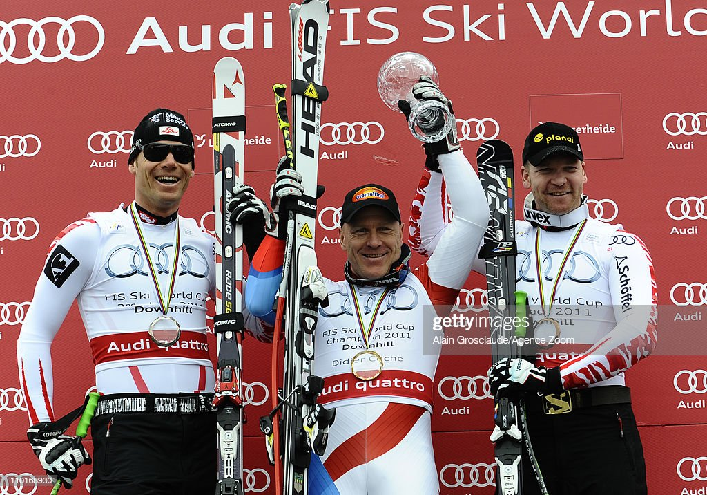 <a gi-track='captionPersonalityLinkClicked' href=/galleries/search?phrase=Didier+Cuche&family=editorial&specificpeople=238957 ng-click='$event.stopPropagation()'>Didier Cuche</a> of Switzerland wins the overall downhill World cup, <a gi-track='captionPersonalityLinkClicked' href=/galleries/search?phrase=Michael+Walchhofer&family=editorial&specificpeople=213500 ng-click='$event.stopPropagation()'>Michael Walchhofer</a> of Austria takes 2nd place in the overall downhill World Cup, Klaus Kroell of Austria takes 3rd place in the overall downhill World Cup on March 16, 2011 in Lenzerheide, Switzerland.