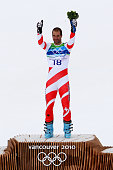 Didier Defago of Switzerland celebrates after taking gold in the Alpine skiing Men's Downhill at Whistler Creekside during the Vancouver 2010 Winter...