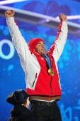 Didier Defago of Switzerland celebrates with the gold medal at the medal ceremony for the Alpine skiing Men's Downhill at Whistler Medal Plaza during...