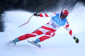 Didier Defago of Switzerland competes during the Alpine Skiing Men's Super Combined Downhill on day 10 of the Vancouver 2010 Winter Olympics at...