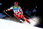 Didier Defago of Switzerland competes in the men's alpine skiing SuperG on day 8 of the Vancouver 2010 Winter Olympics at Whistler Creekside on...