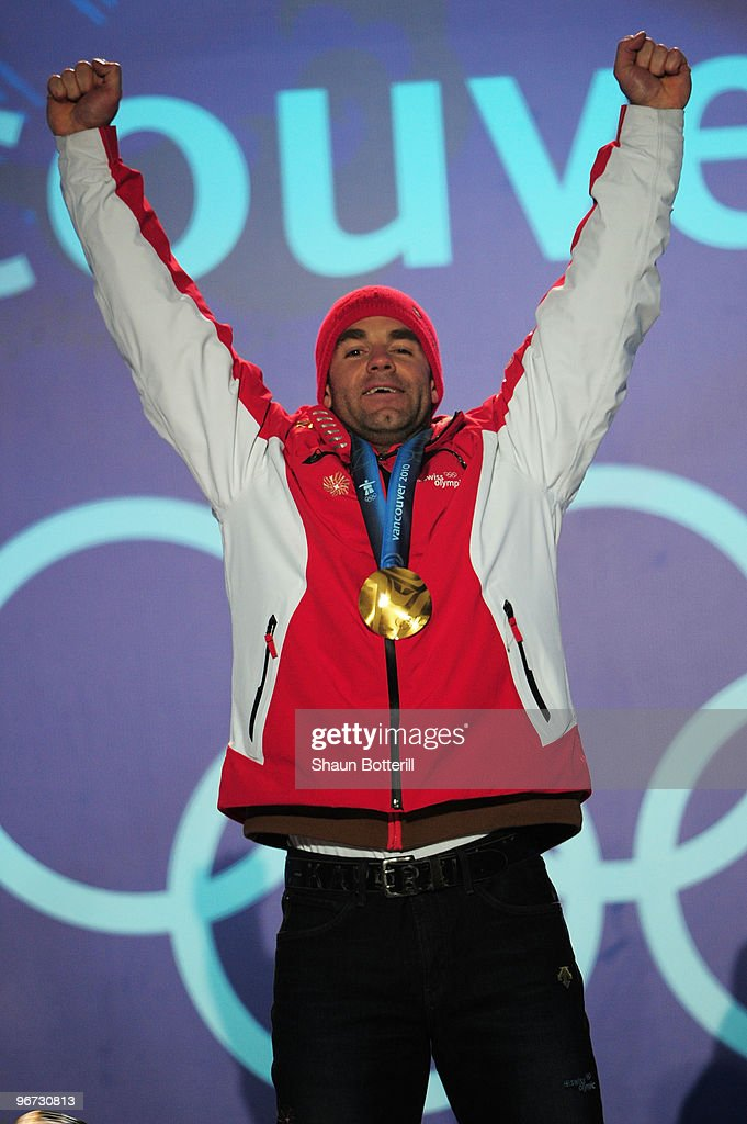 <a gi-track='captionPersonalityLinkClicked' href=/galleries/search?phrase=Didier+Defago&family=editorial&specificpeople=241278 ng-click='$event.stopPropagation()'>Didier Defago</a> of Switzerland poses with the gold medal at the medal ceremony for the Alpine skiing Men's Downhill at Whistler Medal Plaza during the Vancouver 2010 Winter Olympics on February 15, 2010 in Whistler, Canada.