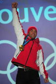 Didier Defago of Switzerland poses with the gold medal at the medal ceremony for the Alpine skiing Men's Downhill at Whistler Medal Plaza during the...