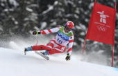 Didier Defago of Switzerland takes the Gold Medal during the MenÕs Alpine Skiing Downhill on Day 4 of the 2010 Vancouver Winter Olympic Games on...