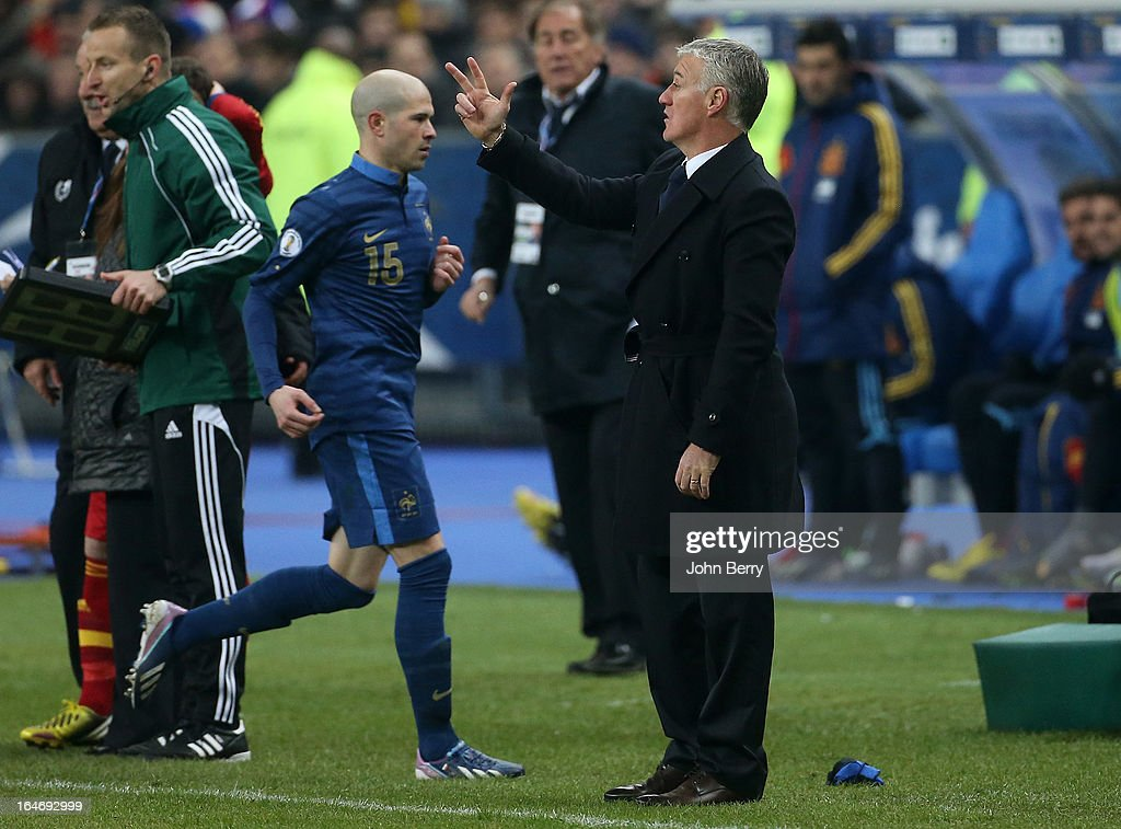Didier Deschamps, coach of France reacts from the sideline while Christophe Jallet is replaced during the FIFA World Cup 2014 qualifier match between France and Spain at the Stade de France on March 26, 2013 in Saint-Denis near Paris, France.