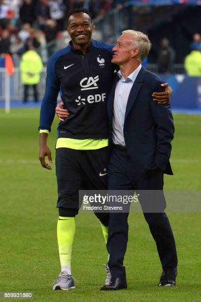 Didier Deschamps head coach and Steve Mandanda goalkeeper of France Football team after the victory of France team during the FIFA 2018 World Cup...