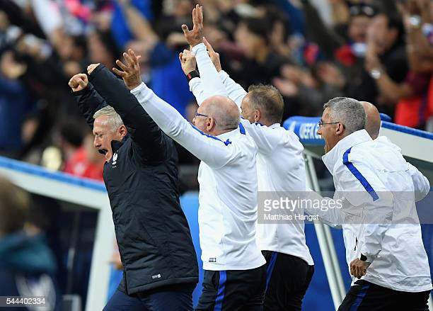 Didier Deschamps manager of France celebrates his team's third goal during the UEFA EURO 2016 quarter final match between France and Iceland at Stade...