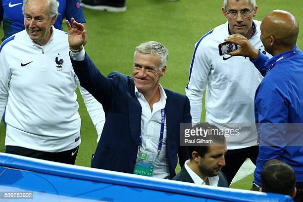 Didier Deschamps manager of France celebrates his team's win in the UEFA Euro 2016 Group A match between France and Romania at Stade de France on...