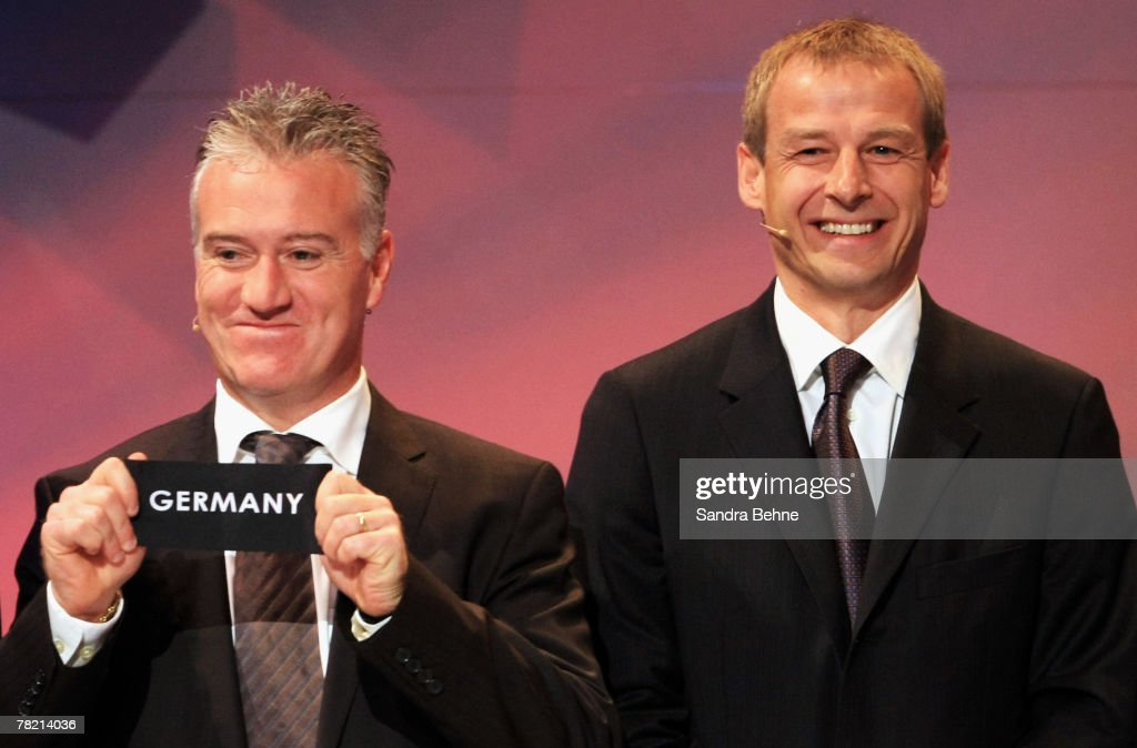 Didier Deschamps (L) of France draws Germany while Juergen Klinsmann (R) of Germany smiles during the UEFA EURO2008 Final Draw at the KKL on December 2, 2007 in Lucerne, Switzerland.