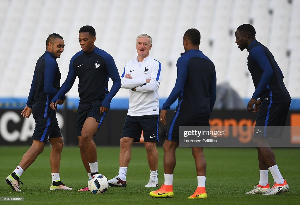 <a gi-track='captionPersonalityLinkClicked' href=/galleries/search?phrase=Didier+Deschamps&family=editorial&specificpeople=213607 ng-click='$event.stopPropagation()'>Didier Deschamps</a> of France shares a joke with <a gi-track='captionPersonalityLinkClicked' href=/galleries/search?phrase=Dimitri+Payet&family=editorial&specificpeople=2137146 ng-click='$event.stopPropagation()'>Dimitri Payet</a> and <a gi-track='captionPersonalityLinkClicked' href=/galleries/search?phrase=Anthony+Martial&family=editorial&specificpeople=9197434 ng-click='$event.stopPropagation()'>Anthony Martial</a> during the France training session ahead of the UEFA Euro 2016 Group A match between France and Albania at Stade Velodrome on June 14, 2016 in Marseille, France.