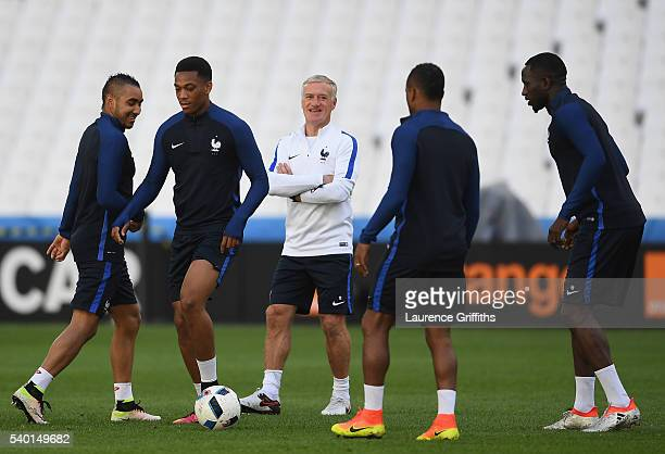 Didier Deschamps of France shares a joke with Dimitri Payet and Anthony Martial during the France training session ahead of the UEFA Euro 2016 Group...