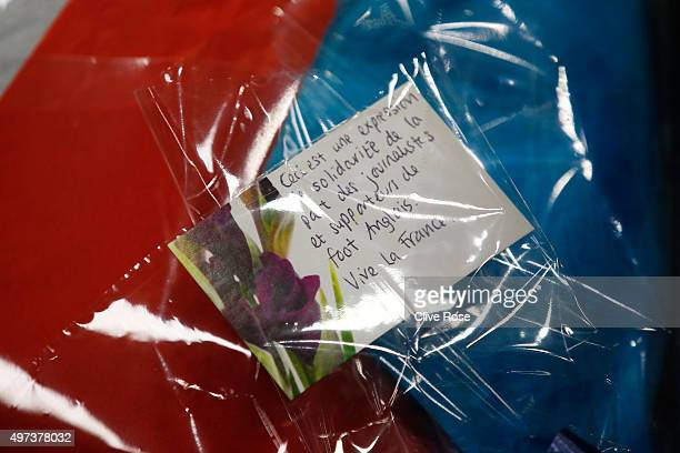 Didier Deschamps the head coach of France receives a bouquet as a gesture of sympathy fom the English Journalists and supporters during the France...