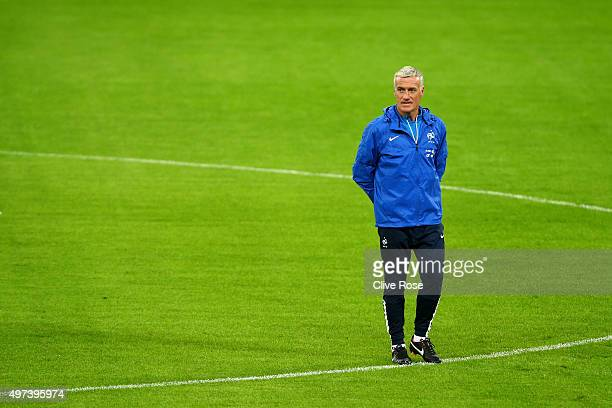 Didier Deschamps the head coach of France watches over his players during the France training session at Wembley Stadium on November 16 2015 in...