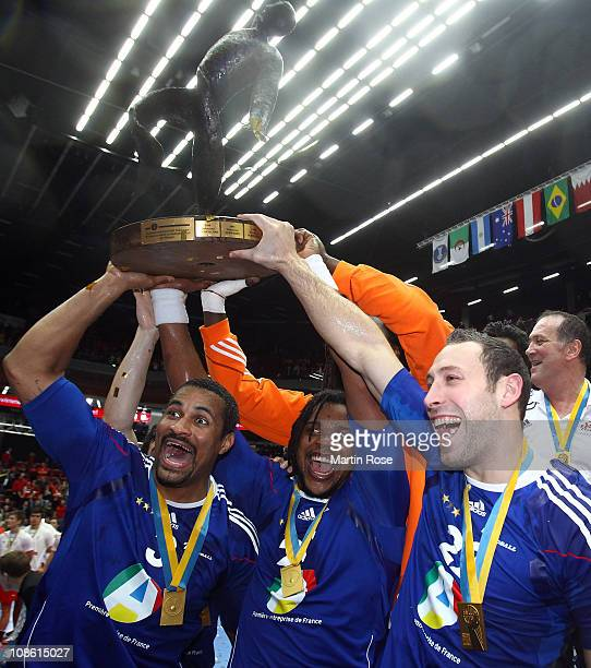 Didier Dinart Cedric Sorhaindo and Michael Guigou of France celebrate after winning the Men's Handball World Championship final match between France...